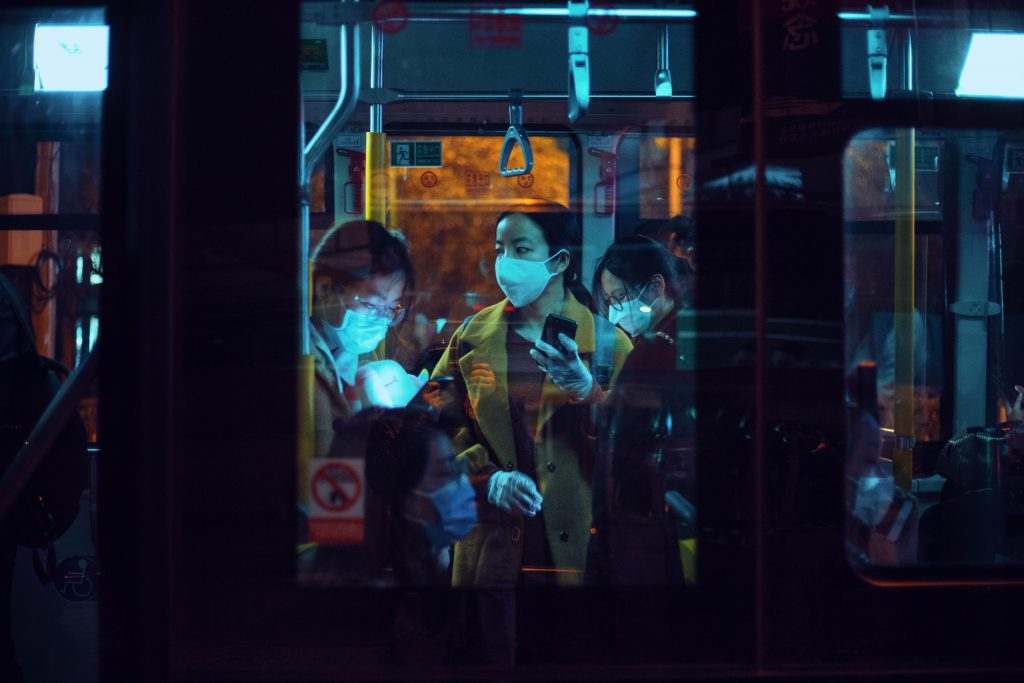 people inside a bus wearing masks 3960076