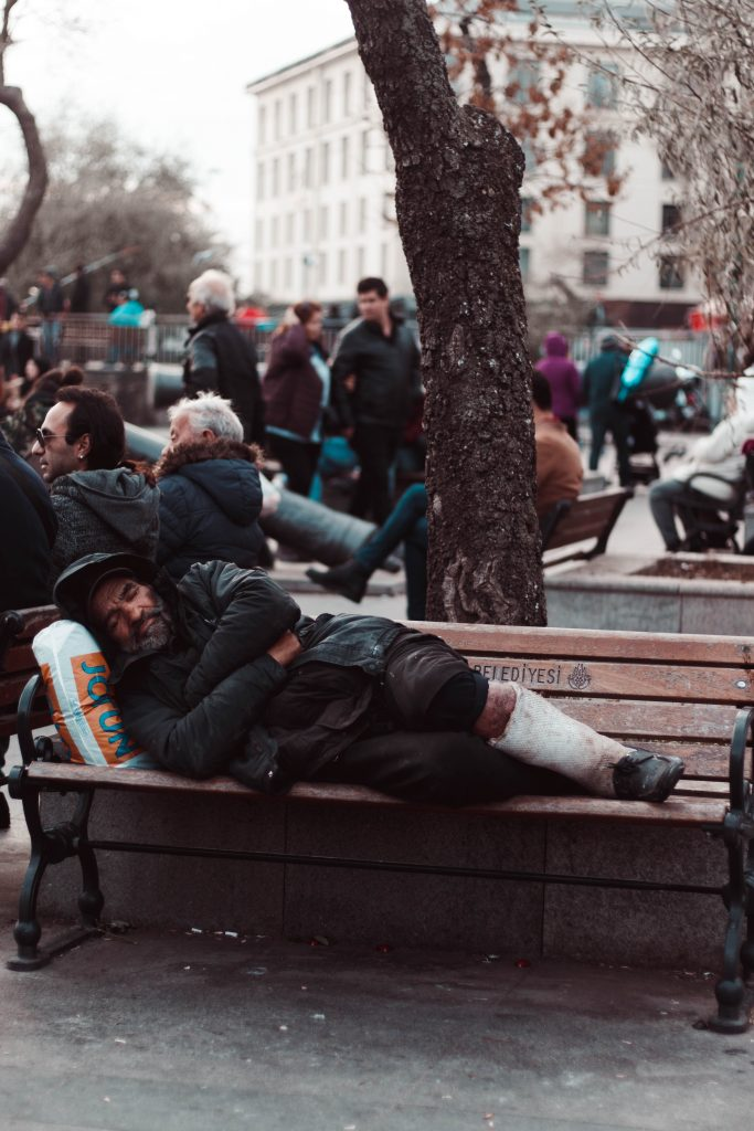 photo of man lying on wooden bench 3617173
